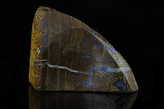 Boulder Opal. Sample of a beautiful natural Boulder Opal specimen isolated on black background stock image