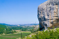 Boulder over the valley. Royalty Free Stock Image