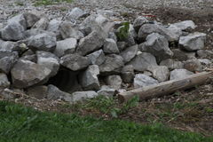 Boulder rocks. Around pipe for water to flow through Royalty Free Stock Photography