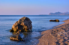 The boulder on a rocky beach of the Mediterranean Sea Royalty Free Stock Photography