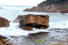 Boulder set against the sea. The Victorian shoreline Royalty Free Stock Photo