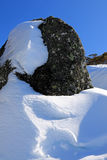 Boulder with snow drift, Kosciuszko National Park NSW Australia. Snowy covered boulder on a sunny winter day Royalty Free Stock Photography