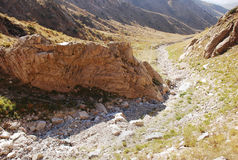 Boulder on the trail in the mountains of Tien Shan Royalty Free Stock Photo