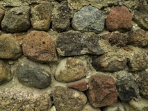 Boulder wall. An old wall made of boulders Stock Photo