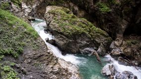 Boulder in wild canyon river royalty free stock photography