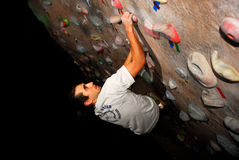 Boulderer. A rock climber climbing a boulder problem in a climbing gym Royalty Free Stock Photos