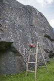 Boulderfels with unfair climbing assistance royalty free stock images