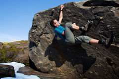 Bouldering. Young man bouldering in the nature environmant Stock Images