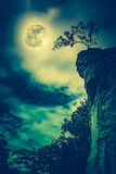 Boulders against sky with cloudy and beautiful full moon. Cross Stock Photography