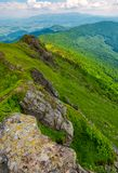Boulders along the mountain ridge. Location Pikui mountain. Borzhava mountain ridge in the far distance on the horizon. Beautiful summer landscape of Royalty Free Stock Photography