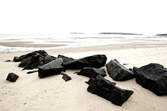 Boulders on Beach Royalty Free Stock Images