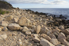 Boulders on the beach along southern coast of Connecticut. Royalty Free Stock Image