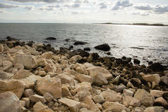 Boulders on the beach along southern coast of Connecticut. Stock Photos
