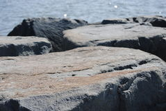 Boulders on a beach jetty Royalty Free Stock Image