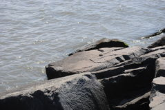 Boulders on a beach jetty Royalty Free Stock Images