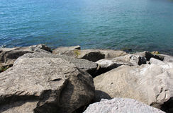 Boulders and blue lake Stock Photos