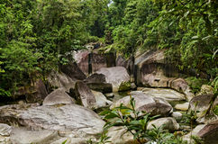 The Boulders, Cairns. South of Cairns in Queensland, a tourist attration called The Babinda Boulders. It is a swimming hole that also has significance to the stock photo