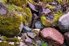 Boulders close up, stacked. Various brown and mottled boulders close up, stacked, some of them overgrown with moss and grass royalty free stock photo