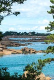 Boulders on the coast near Saint Guirec, at low tide (France) Royalty Free Stock Photos