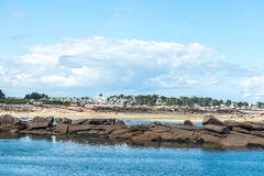 Boulders on the coast near Saint Guirec, at low tide (France) Stock Images