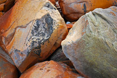 Boulders with corrosion. Several boulders covered with rust Royalty Free Stock Image