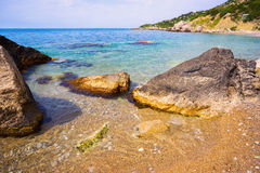 Boulders on a deserted beach of the black sea . Stock Photography