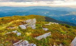 Boulders on the edge of hillside. Lovely view from Runa mountain, Ukraine. cloudy august morning stock photography