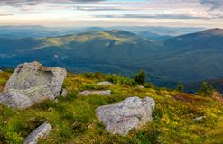 Boulders on the edge of hillside. Lovely view from Runa mountain, Ukraine. cloudy august morning stock image