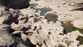 The boulders is eroded. The boulders eroded by the water royalty free stock images