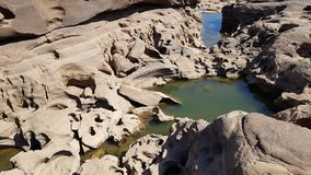 The boulders is eroded. The boulders eroded by the water stock photography