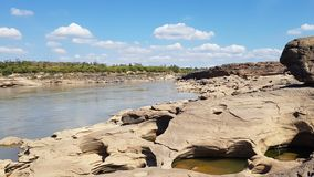 The boulders is eroded. The boulders eroded by the water royalty free stock image