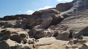 The boulders is eroded. The boulders eroded by the water royalty free stock photography