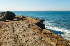 Boulders and Erosion of Cliff Edge at Point Loma Tidepools. Boulders and erosion of cliff edge at the Point Loma tidepools in San Diego, California Royalty Free Stock Photography
