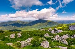 Boulders on grassy hill in summer. Lovely nature scenery under the cloudy sky in Carpathian mountains, Ukraine Stock Images