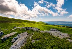 Boulders on a grassy hillside in summer. Beautiful mountainous landscape in wonderful weather condition Stock Images