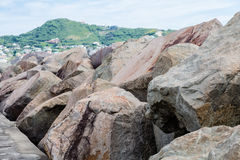 Boulders by Green Hills Stock Image