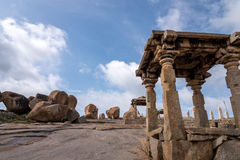 Boulders in Hampi. Remains of temple and huge boulders against blue sky royalty free stock image