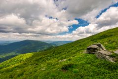Boulders on the hills of Runa mountain. On a cloudy day. beautiful Carpathian landscape in summer time Royalty Free Stock Image