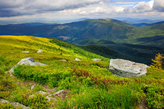Boulders on the hillside in high mountains Royalty Free Stock Images