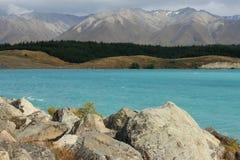 Boulders at lake Pukaki Stock Images