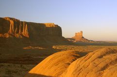 Boulders and mesas in Monument Valley. Boulders and mesas lit by the setting sun in Monument Valley, Navajo Nation Royalty Free Stock Image
