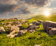 Boulders on the mountain meadow at sunset Stock Photos