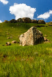 Boulders. The mountainous region at the Sterkfontein dam near Harrismith in South Africa. The sharp escarpments have large boulders at the foot of the hills from royalty free stock photography