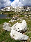 Boulders and mountains. Quartzite boulders and the Snowy Range Mountains royalty free stock photo
