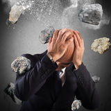 Boulders rain. Man protects himself from a boulders rain Stock Images