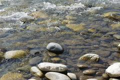 Boulders in the river Stock Images