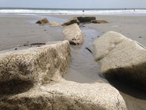 Boulders in the sand Stock Photo