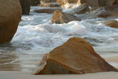 Boulders at sea. Granite boulder over washed waves backgroud in puerto vallarta mexico Stock Image