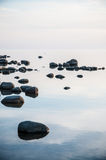 Boulders in the sea Royalty Free Stock Image