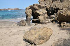 Boulders by the sea Stock Photography